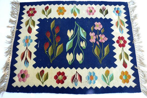"VIntage Romanian Kilim Wall Hanging Flowers by LunaParkVintage, $75.00  Kilim wall hanging from Romania ::: -- classic Romanian design probably from the Moldovia region -- stunning flowers with fringe border ::: Dimensions ::: -- 20"" x 16"" with 1 1/2"" fringe on two sides. ::: Condition ::: -- very good condition - some worn areas where the weave is pulling apart (see photos). -- no stains"