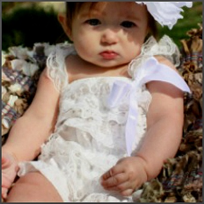White Vintage Romper. This gorgeous custom made vintage romper was created to have your little angel looking like one! Made in vintage white lace, fully lined on the inside for a comfortable fit and embellished with a white satin bow, this is a truly memorable outfit for every special occasion!