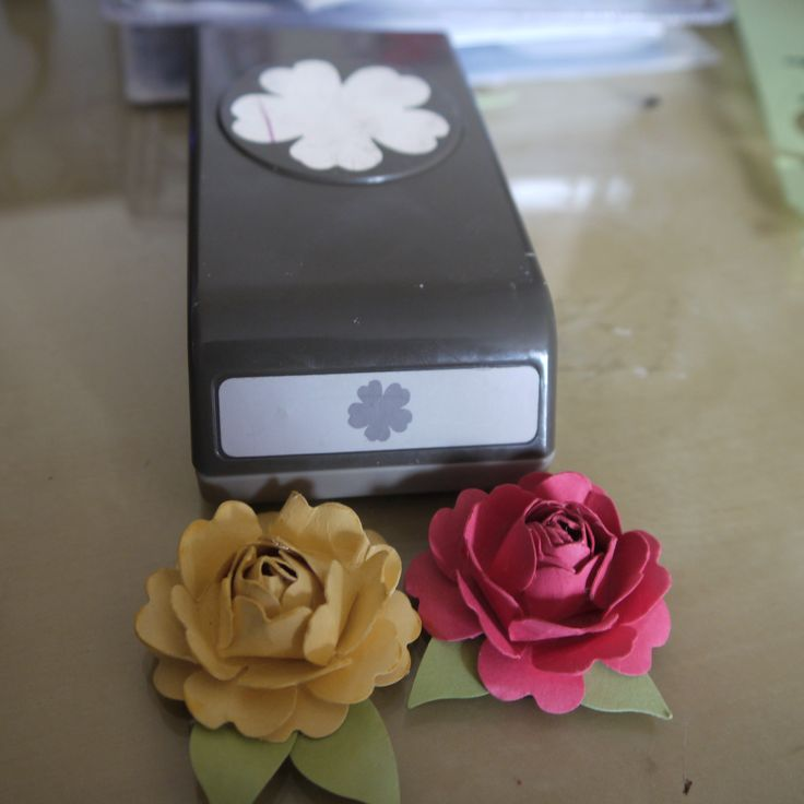 Make beautiful flowers from paper punch -outs
