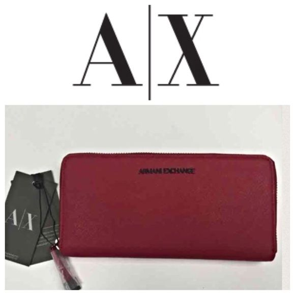 Armani Exchange large wallet NWT Brand New With Tags*  * Armani Exchange Continental Wallet - can be worn as a clutch  * steel emblem plates * 8 card slots * 4 money holder slots * 1 zipper coin pocket * 8 X 4 * 100% saffiano leather Armani Exchange Bags Wallets