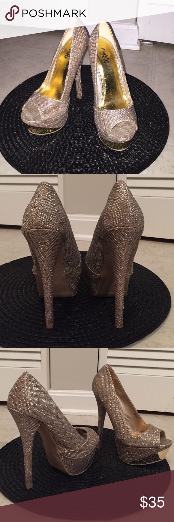 7inch Glitter sparkly pumps! Slightly used GOLD sparkly pumps! Great for New Years or just a flirty night on the town! Very tight, fits more like a 6.5 🙂 Charlotte Ronson Shoes Platforms