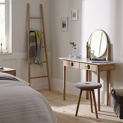 This beautifully crafted dressing table is complemented by a marble top and brushed solid brass handles, making it a striking addition to any bedroom.Two front drawers open out to provide ample storage, whilst the large round mirror will create a sense of light and airiness in space deprived rooms.