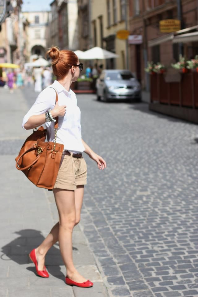 ballerina bun + white button down + belted khaki shorts + camel tote + red ballet flats