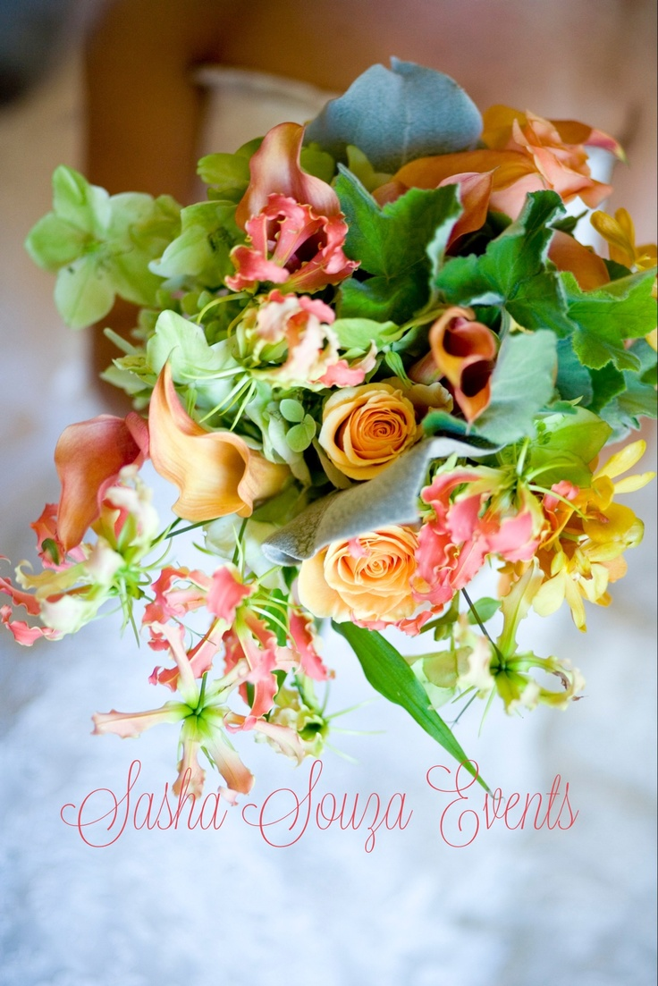 Daily Pretty: Light-hearted and romantic bridal bouquet in tones of peach, green, blush and yellow with calla lily, Ecuadorian roses, Vanda orchids, hellebores, lambs ear, geranium leaf, lambs ear and gloriosa lily. Image by Susan Stripling