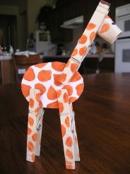 I want one mom!!! lol. Clothes Pin Giraffe. This is an easy craft for kids! You just need some paint (or markers), wooden clothes pins tape and a little imagination!   Once the kids get their giraffes made, then you can talk about giraffe facts or just take a wild adventure in your safari!