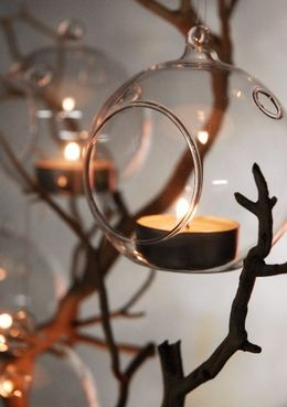 "15.00 SALE PRICE! Delicately illuminate the branches of a tree with this set of 6 hanging glass tea light holders. Each glass orb is 3"" wide with 1-3/4&..."