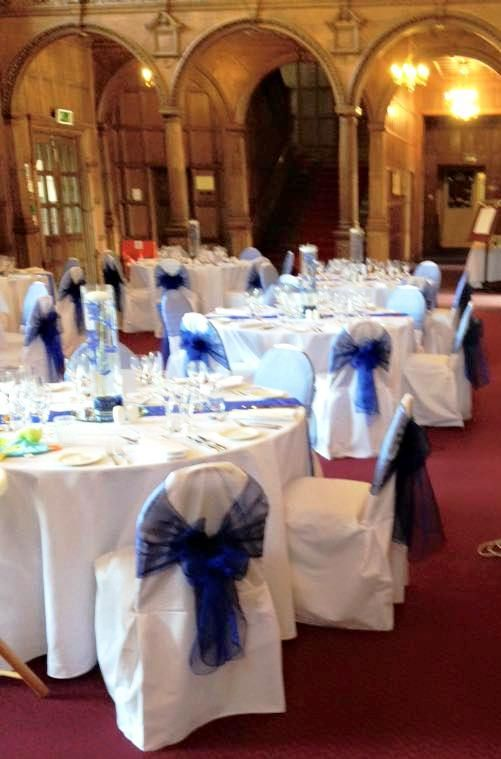 Royal Blue sashes on white cotton chair covers at Mill Hall from Simply Bows and Chair Covers