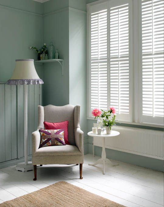 green and shutters and chair
