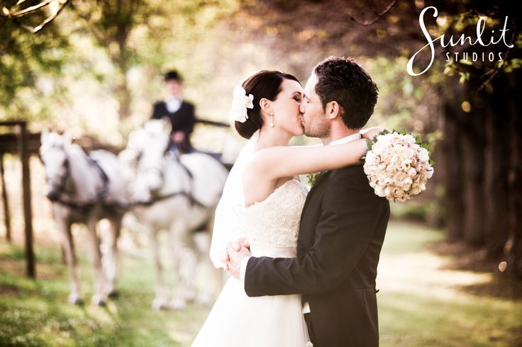 Fairytale wedding with horse and carriage, princess dress and classic hair