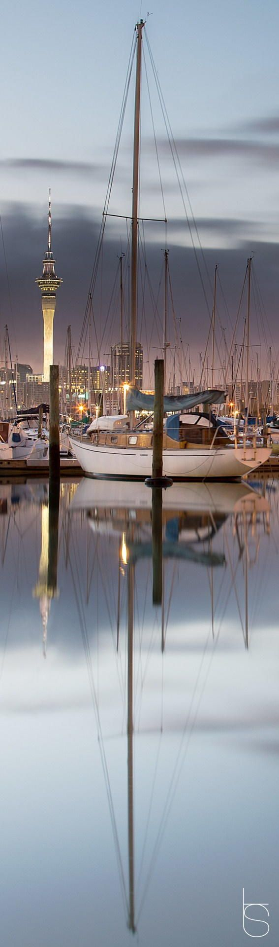 Yacht, sunrise over Sky Tower taken in Westhaven Marina, Auckland, New Zealand.  Photo by Tomas Stehlik