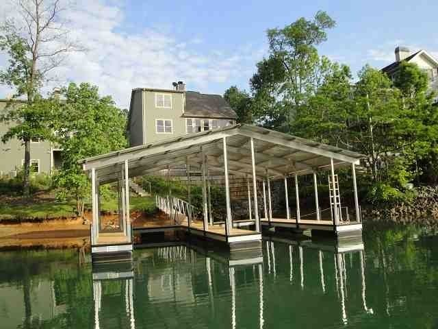 Lake Keowee Townhouse in fantastic location. Located 1/2 mile from Lake Keowee Marina/Tiki Hut, 7 miles from Clemson University, 45 minutes from Greenville. Great view, deep water, covered boat slip included(shared dock). Beautiful hardwood floors, granite countertops/eat-in bar, and stainless appliances. Stone fireplace w/ gas logs. Tongue and groove pine vaulted ceilings. Main level master bedroom. Gigantic walk-in closet. Spacious, finished lower level offers an awesome...