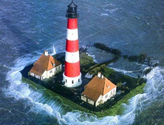 Early 20th century lighthouse of Westerhever, located on the Eiderstedt Peninsula in Germany's Schleswig-Holstein region.