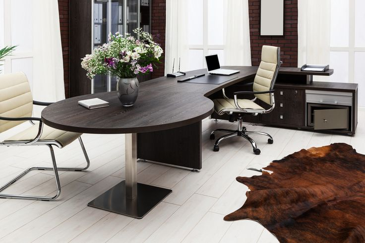 Modern home office with light wood floor and dark wood desk with cream colored office furniture
