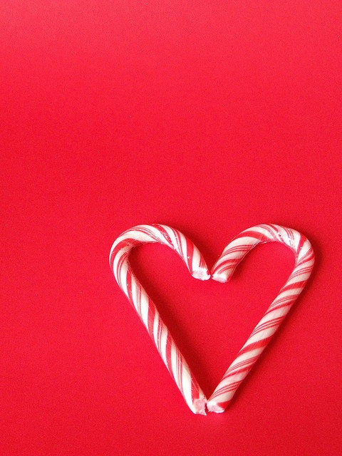 Candy cane heart....fill with chocolate or white melts, top with food glitter or sprinkles...add a  lollipop stick, wrap... and gift!