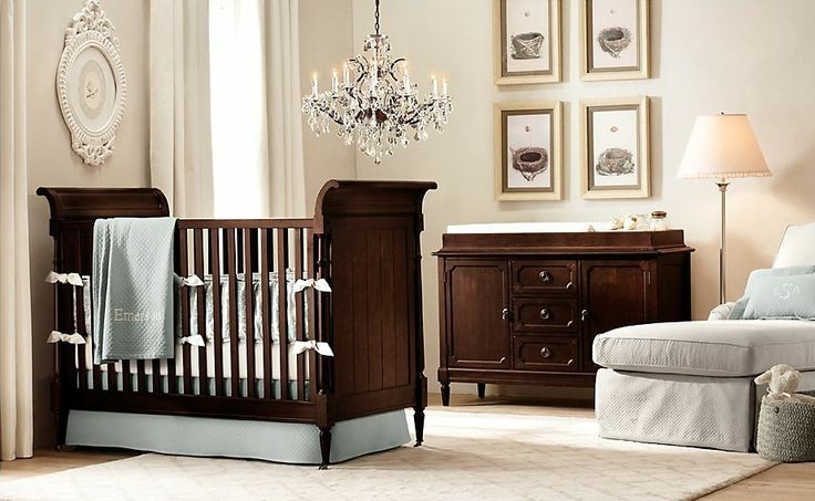 Rich, dark, wooden furniture is classic and bold in a soft, creamy nursery.