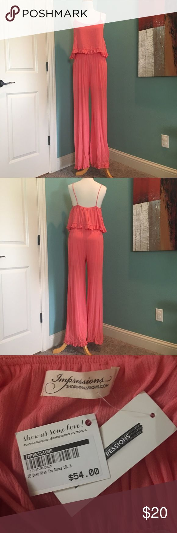 Coral Jumpsuit NWT Coral Jumpsuit. Crepe-y material.  Small ruffle around bottom of pant legs.  Super cute!  Would look great with a summer tan. Pants Jumpsuits & Rompers