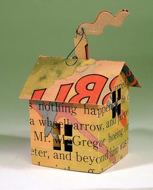 paper house made from upcycled books - would make cute Christmas ornament or baby shower decoration
