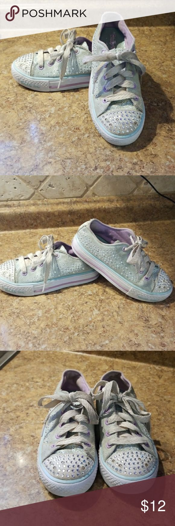 Skechers Twinkle Toes Sneakers Girls Twinkle Toes Sneakers size 13.5. All the Twinkls still work. I have not tried to wash theses. Color is a pale blue and lilac. BUNDLE for more savings Skechers Shoes Sneakers