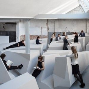 """Conceptual office swaps chairs and desks for """"experimental work landscape"""""""