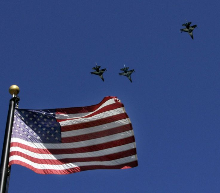 F-16's in Missing Man formation over Old Glory