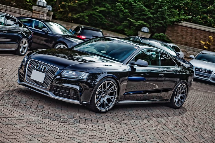 Audi RS5 . I'm a real AUDI freak and i actually have a picture of this car stuck on the dashboard of my little match box car ;-D. Testing the law of attraction?