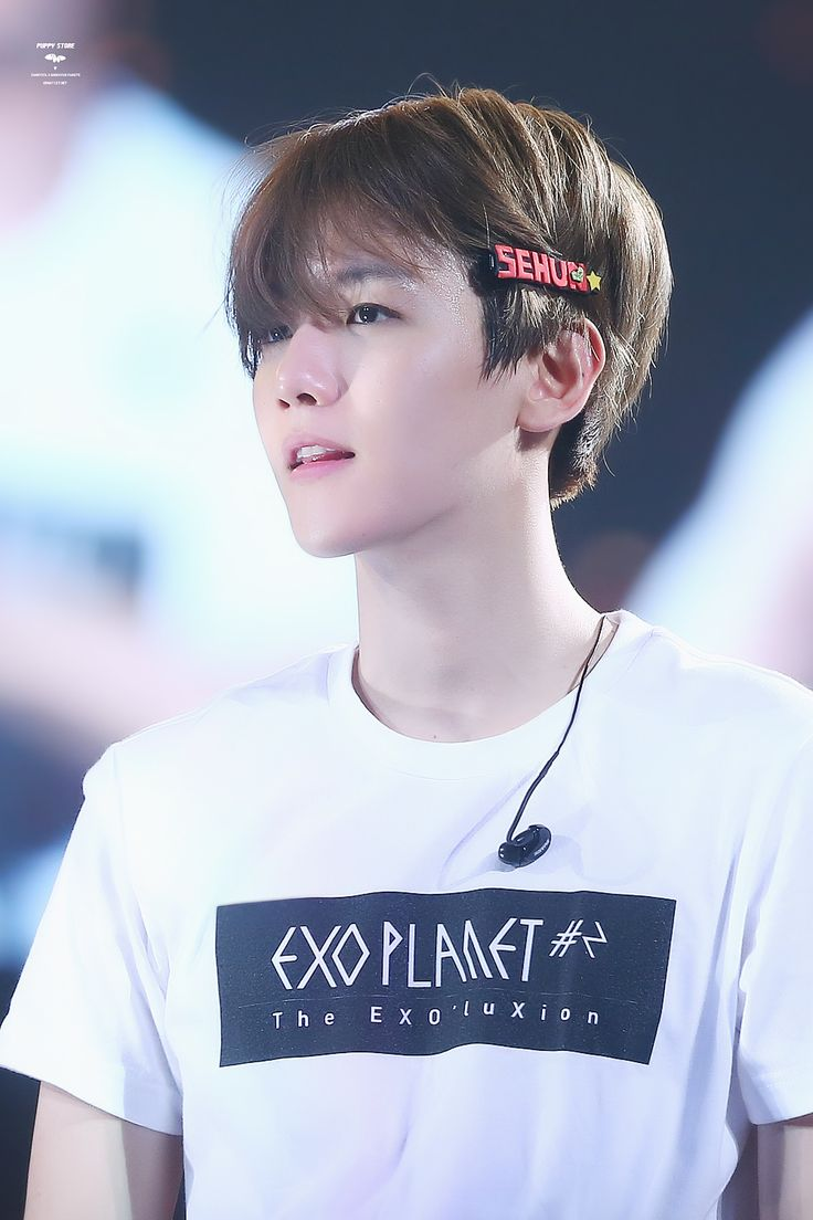 Baekhyun. am I the only one who notices that he has a hair clip with Sehun's name on it in his hair? Someone please comment on this.