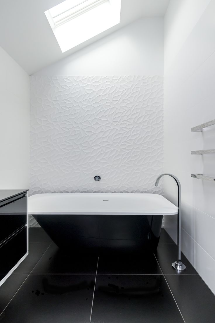 We wanted to create a space that was relaxing but would also be timeless. Black and white is timeless and will look beautiful wherever you use it and no matter how long it is there. The tiles were selected and laid in a way to accentuate the length & height of the room. This makes the space feel a lot larger than it actually is.