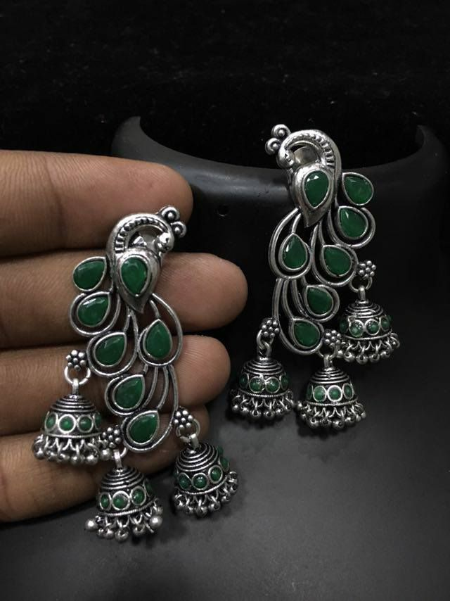 Beautiful jumkhis studded with green color stones. Jumkhis with peacock design.