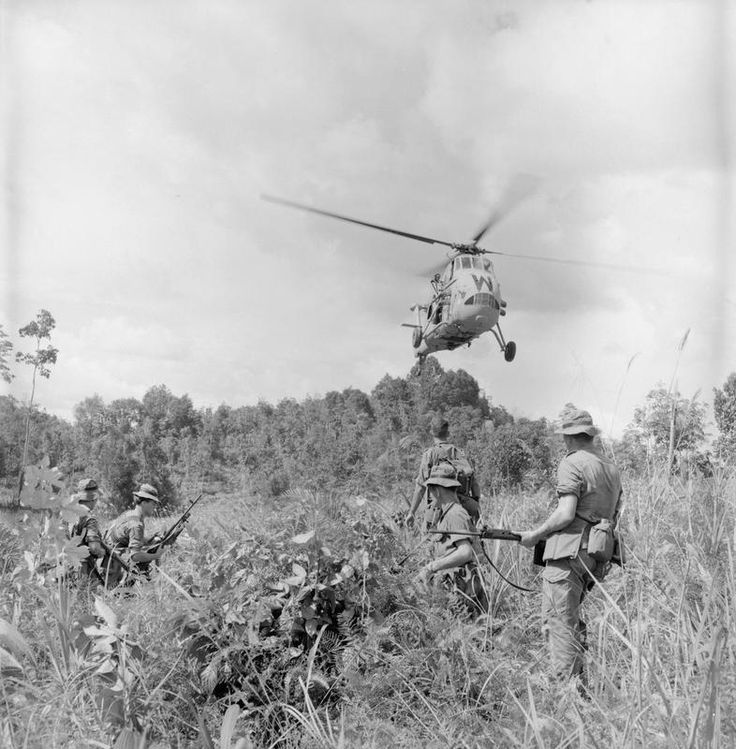 Operating in Borneo during the Indonesian Confrontation British troops wait, as a Westland Wessex HAS.1 of 845 Naval Air Squadron lands to pick them up after the completion of patrol.