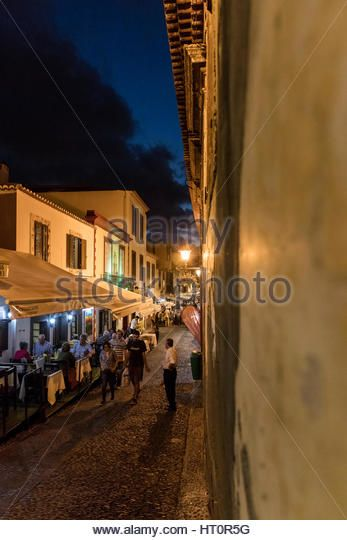 Open air restaurants at night in the Old Town of Funchal, Madeira - Stock Image