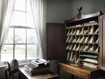 Eudora Welty's writing room. The set of pigeon-holes/cupboard item is called a secretary. I like it a lot.