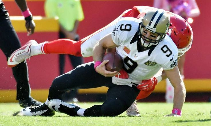 Saints vs. Chiefs  -  27-21, Chiefs  -  October 23, 2016:    New Orleans Saints quarterback Drew Brees is sacked by Kansas City Chiefs defensive back Daniel Sorensen int he second quarter during Sunday's football game on October 23, 2016 at Arrowhead Stadium in Kansas City, Mo.
