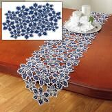 "Exquisite cutwork table linens are 100% polyester for easy care. Placemats come with a set of 4. Machine washable. Imported.Runner is 13"" x 72""Place mats are 12"" x 18"" each"
