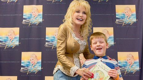Dolly Parton hand-delivers millionth UK Imagination Library book