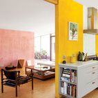 The kitchen of the  Devis-Purdy house in Los Angeles features dual bursts of color and light. Though the appliances and cabinets are well...