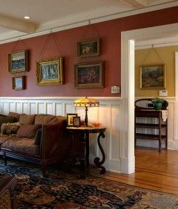 Crown Moulding - that does double duty, it can give a room some architectural interest, and you can hang pictures from it.  No more holes in the walls.
