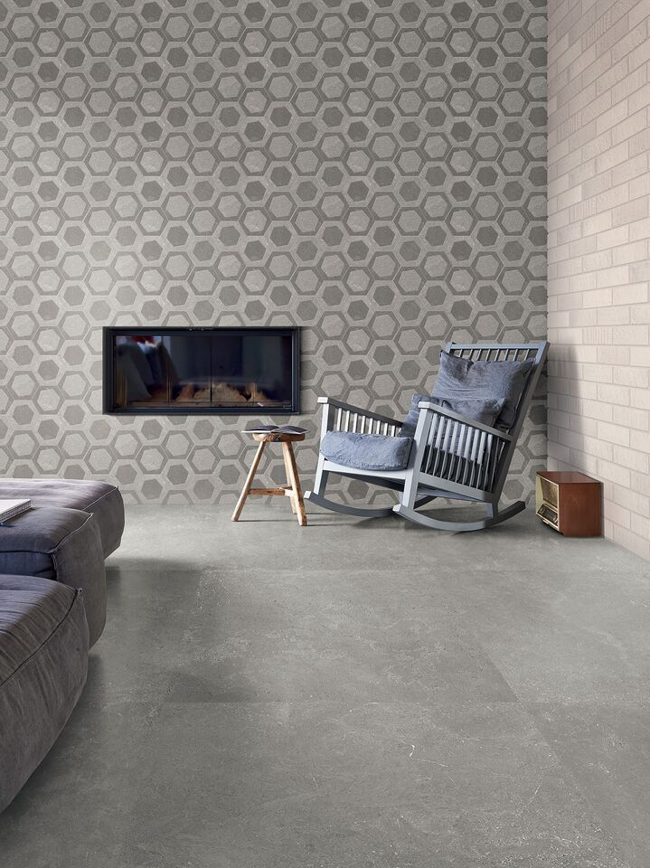 Emilceramica - Milestone. A grey stone floor covering from the Milestone collection conveys an extremely natural feel, creating a modern and sophisticated urban interior. #Cersaie2015