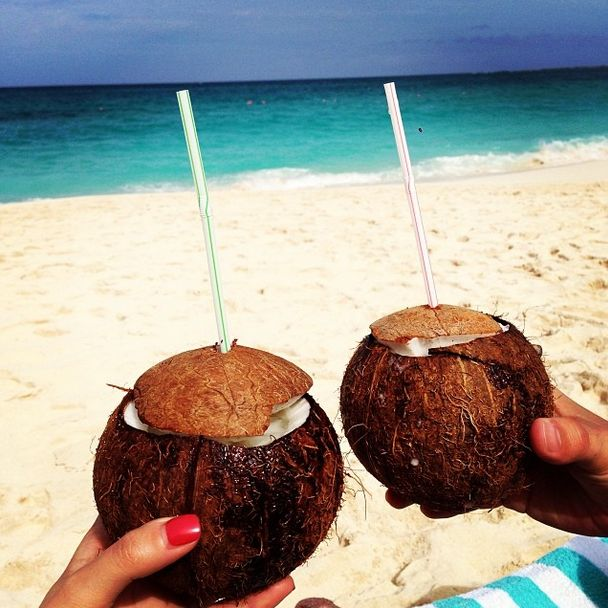 Coconut cocktails on the beach! The perfect vacation.