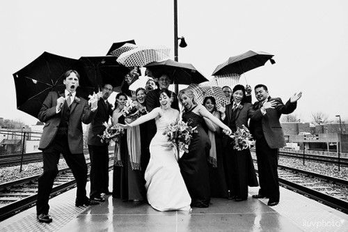 They didn't let rainy day stop from getting a great wedding shot!