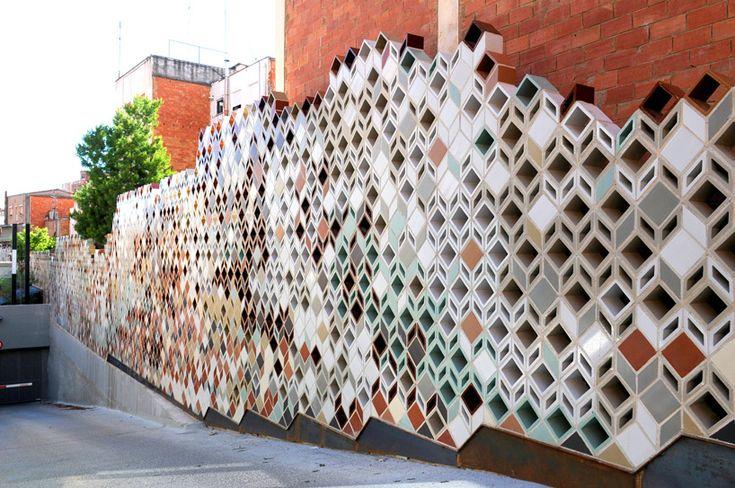 ceramic wall delineates la riera de la salut by pol femenias in spain