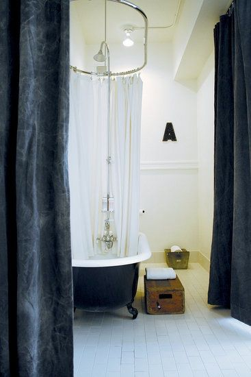 Ace Hotel bathroom with black painted tub.