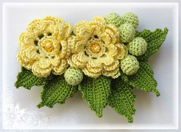 Yellow flower pin with diagrams
