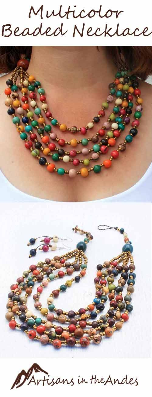 This vibrant bib necklace features five cascading rows of acai beads. A symphony of color, this Fair Trade necklace is inspired by the hues of nature and includes royal blue, creamy beige, lush greens, ruby reds, and more colors than can be described.
