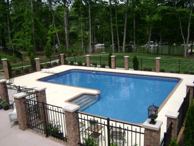 I actually like this fence around the pool and with even a larger paver area, it would be more spacious.