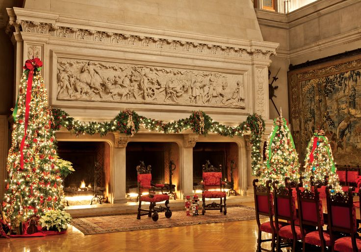 Santa, may I have a plane ticket to visit this place? Massive triple hearth fireplace warms up the dining room for an elegant Christmas dinner at the Biltmore Estate in NC.