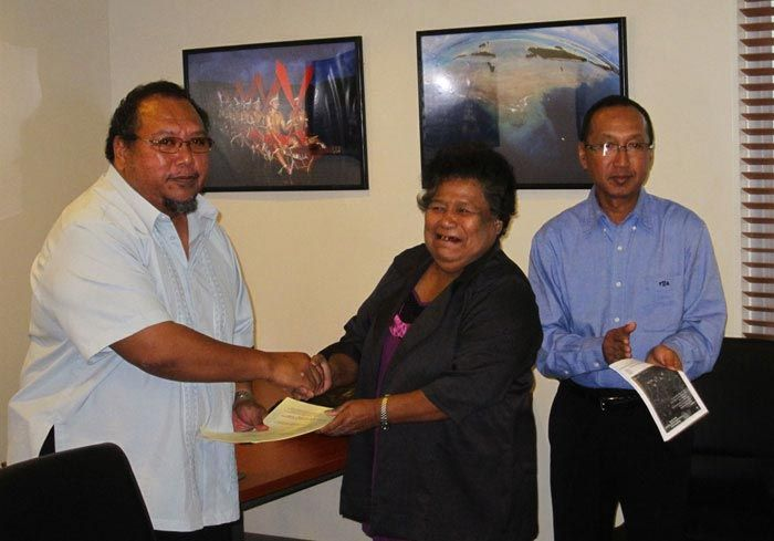 I helped usher sites into the Palau Protected Areas Network (PAN) as Program Director for the PCS Conservation and Protected Areas Program.      Palau's Minister of Natural Resources, Environment, and Tourism Harry R. Fritz accepts Ngardmau State's PAN Application from Governor Akiko Sugiyama. Minister of State Victor Yano applauds. PCS helped Ngardmau develop its PAN application. ©PCS.