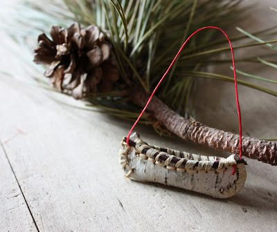 A lovely tutorial on how to make a mini birch bark canoe ornament. I need a few of these for the woodland theme tree this year!
