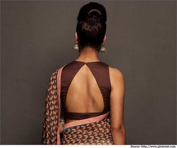 #Blouse back design with triangle shape neck type can be worn with simple printed or even cotton sarees.