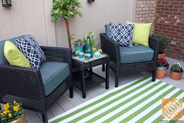 Small Deck Decorating Ideas: Hampton Bay Fenton Chat Set with a green striped outdoor rug and potted plants
