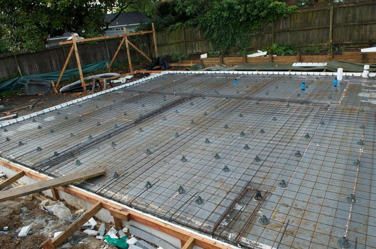 The lower level floors of the house are concrete.  'Eurosteel' reinforcing bars connect from the footings, as well as the insitu concrete wa...